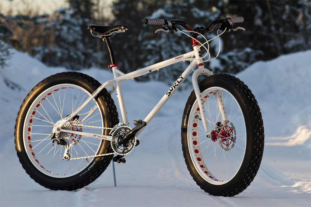 A Surly Pugsly fat bike rests on a snowy road