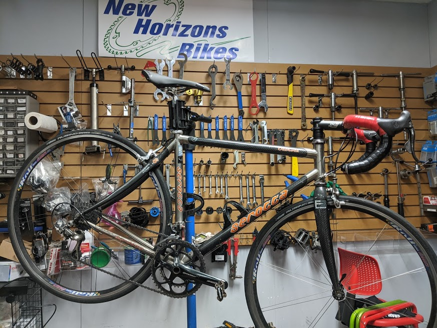 Bicycle repair area with tool wall and road bicycle in workstand