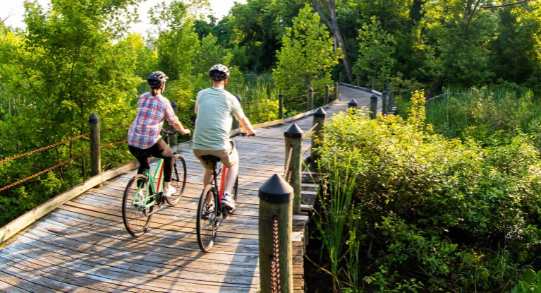 Couple riding bikes on bike path