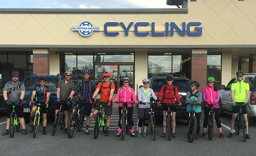 Group of cyclists in front of Slipping Gears Cycling