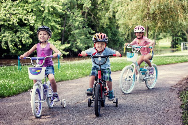 three kids riding bikes
