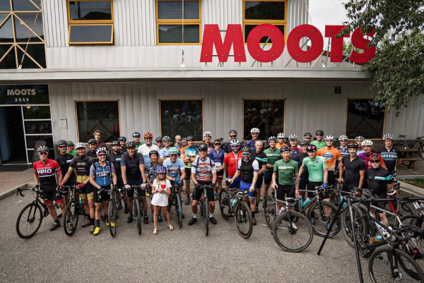 riders in front of moots factory