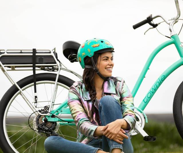 Woman sitting next to commuter bike