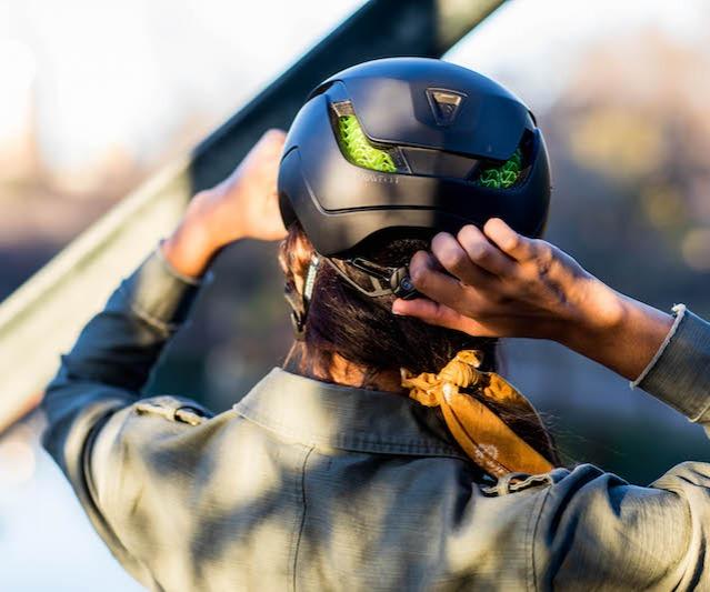 Rider adjusting helmet