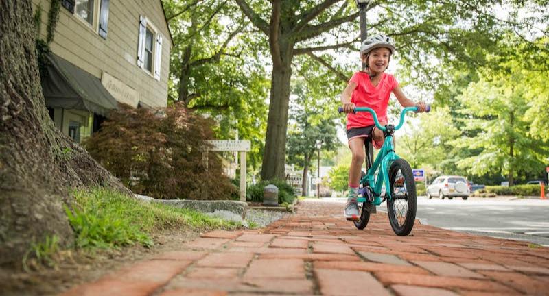 Girl on 16-inch kids' bike