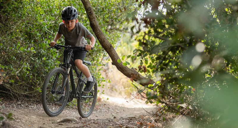 Boy on 24-inch kids' bike
