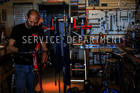 Man services a road bike.