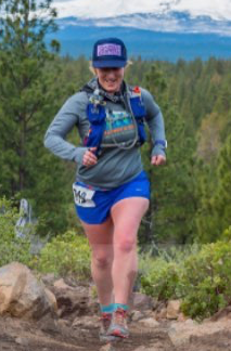 Mary Miller, Footwear Buyer at Sport Systems running on a trail