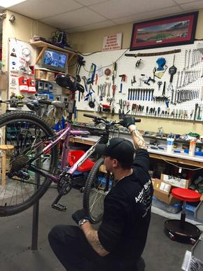 Travis, also an owner, works on the bikes