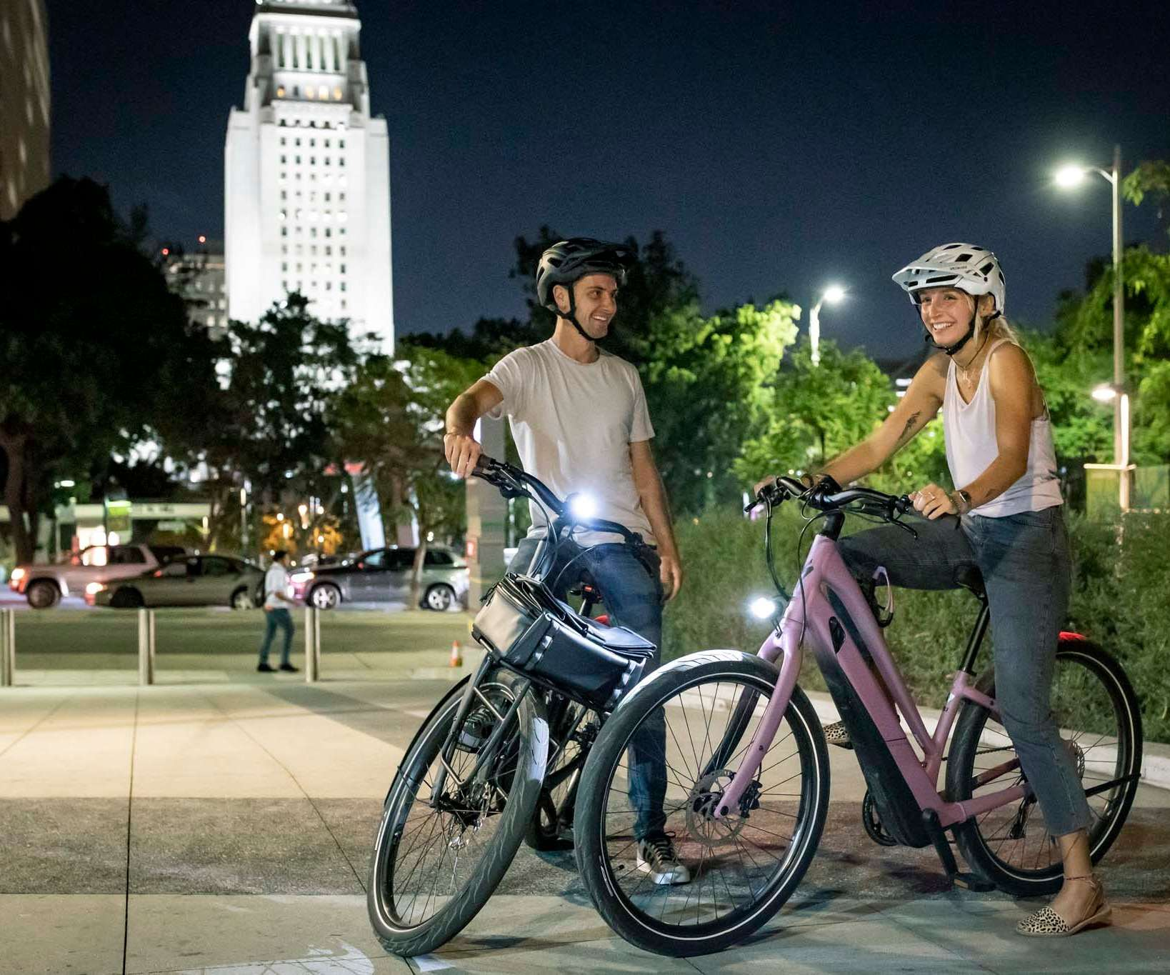 couple on eBikes at night