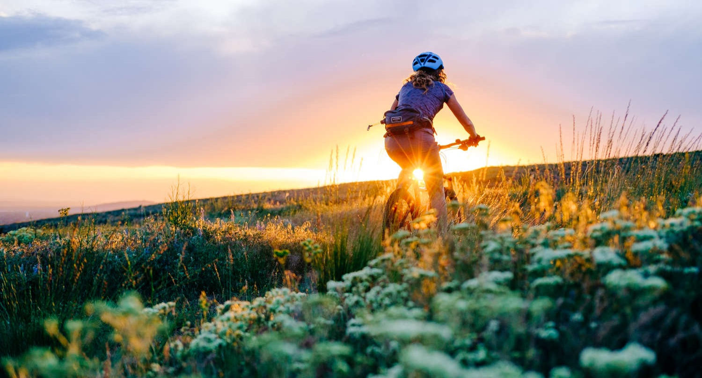 woman mountain biking saltese