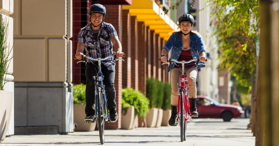 Couple riding hybrid bikes