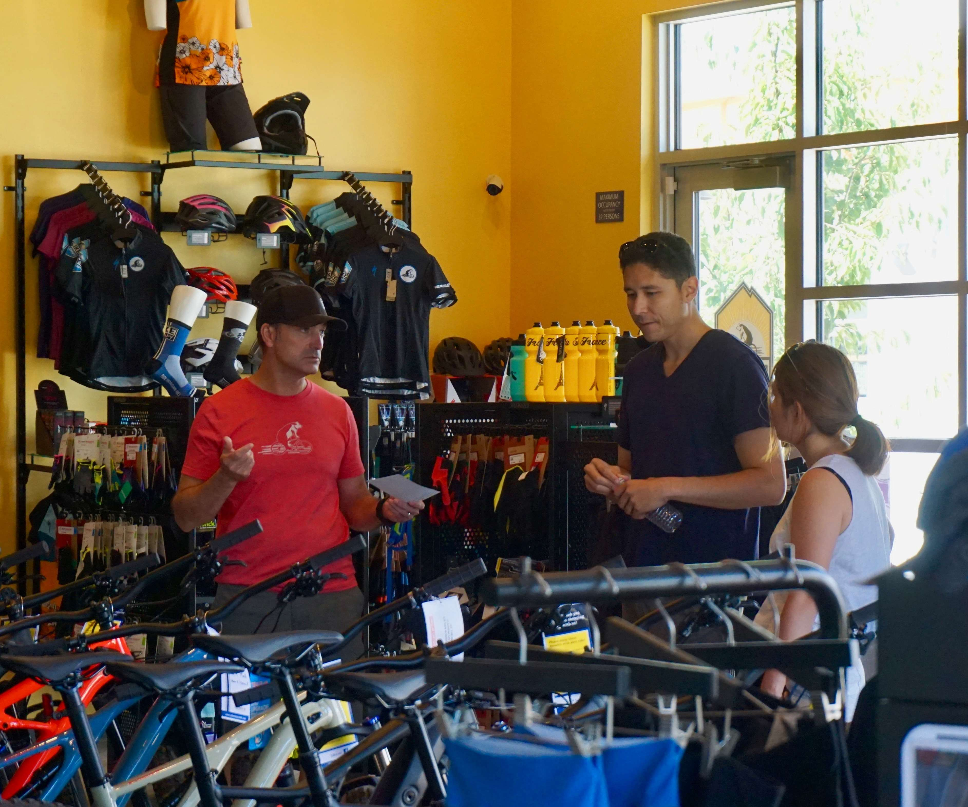The store owner helping two customers pick their perfect bike