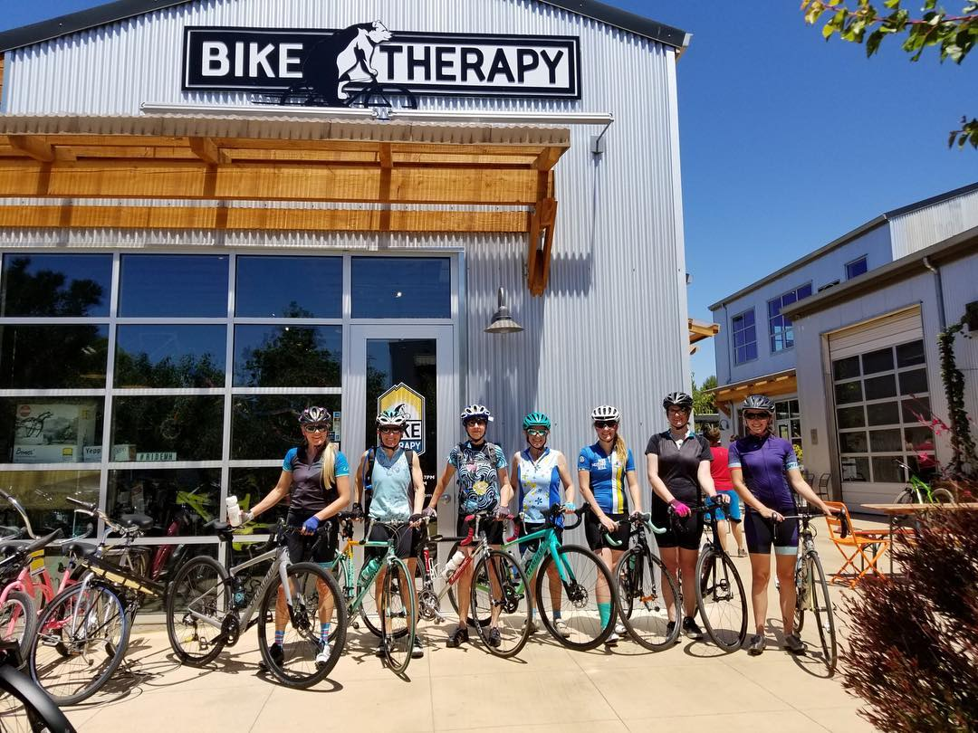Bike Therapy Storefront with Riders