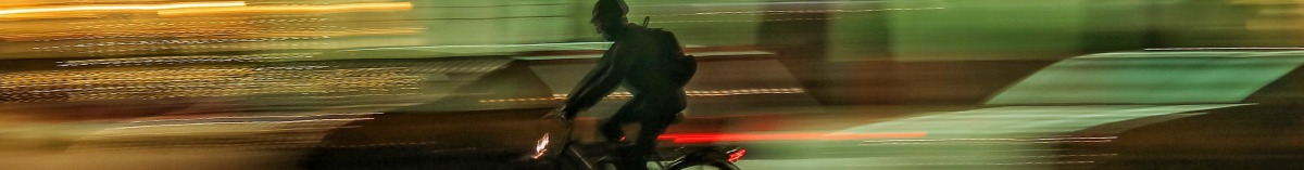person riding a bike with lights