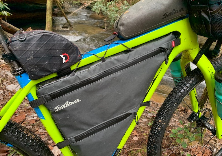 person with bike and bike frame bags