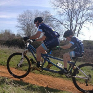 Dan Tebbs riding a tandem with his son