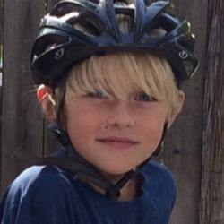 Tebbs child wearing a bicycle helmet
