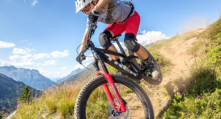 Rider on a full-suspension mountain bike