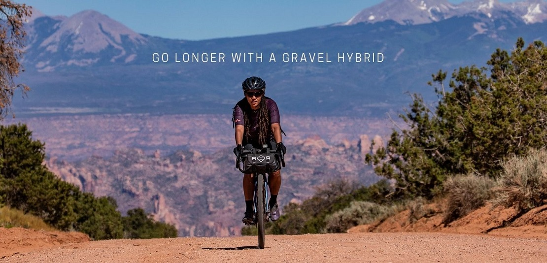 Woman riding a Liv Devote Gravel Bike on Gravel Road in mountains