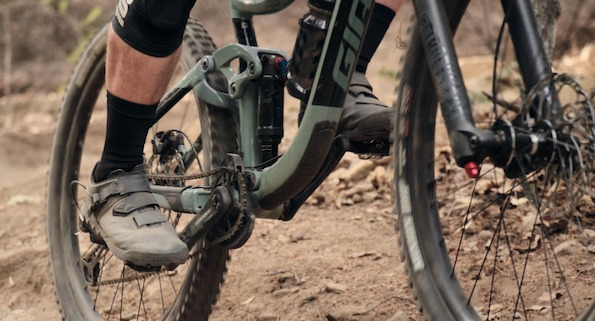 People riding mountain bikes with mountain shoes