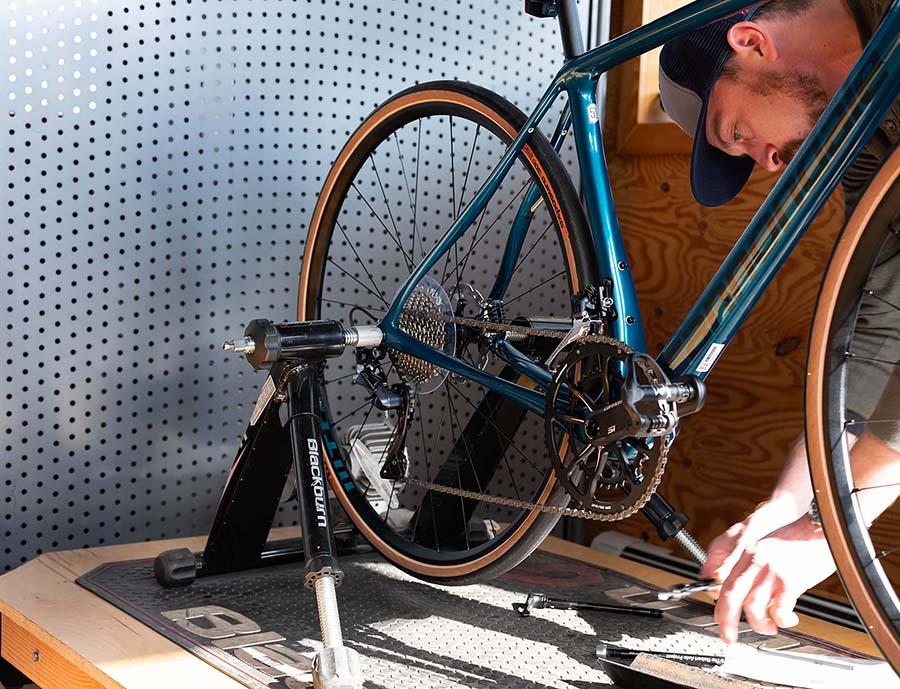 Montlake bicycle shop setting a road bike in the fit trainer in the Montlake Bicycle Shop fit space.