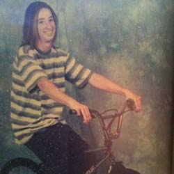 Rob at about age 14 sitting on his BMX bike.