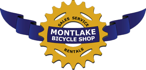 Montlake Bicycle Shop Logo- a gold chain ring with a blue banner through the center. The words Sales, service, and rentals overlaid on the chain ring.