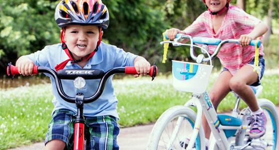 two kids on bikes