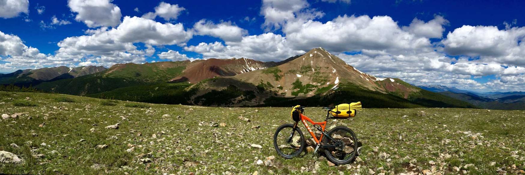 bike in a field with mountain backdrop