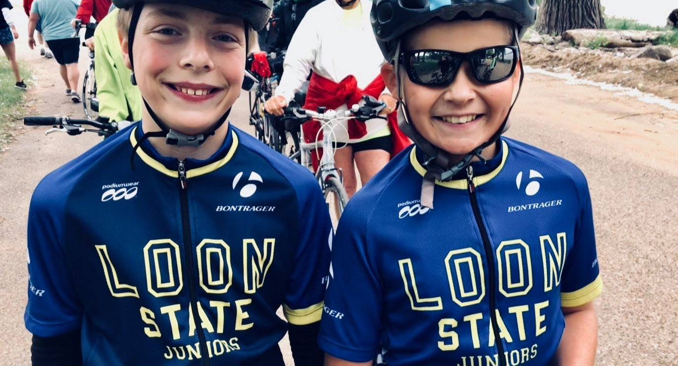 Two young Loon State Junior cyclists pose for a photo