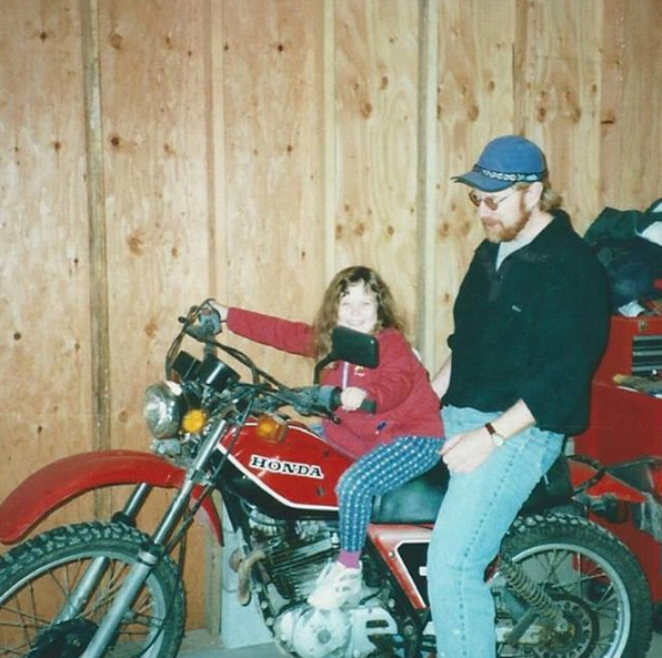 small Mikaela on her dads moto.