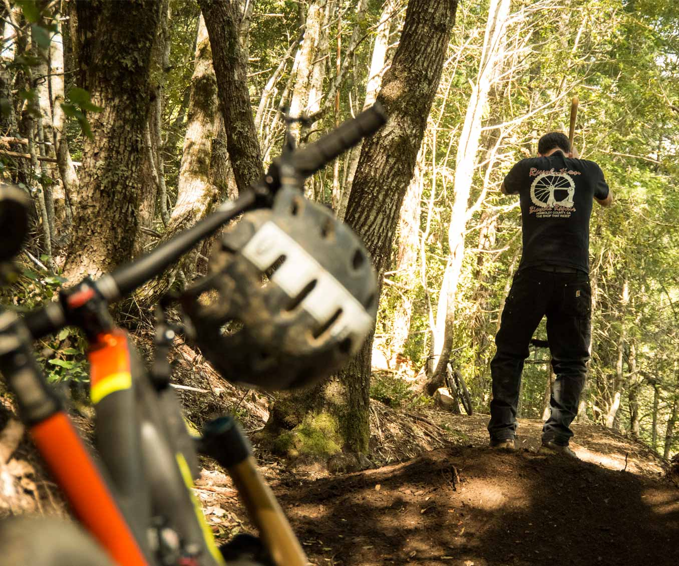 Owner Sean Tetrault digs trail at Lacks Creek