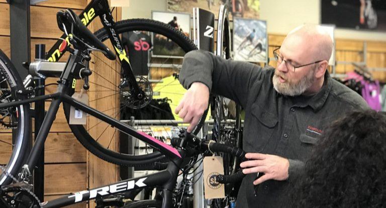 Bike Technician explaining features on a bike.