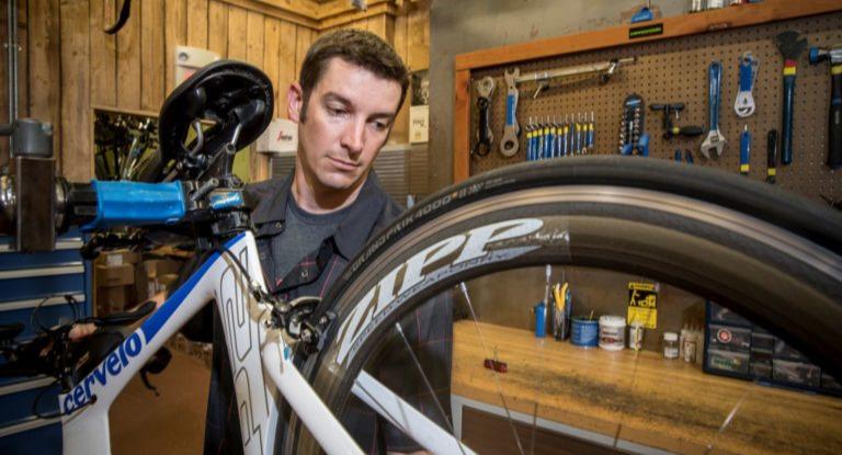 Bicycle Technician working on a triathlon bike.