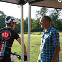 Mountain biker talking to a ride staff.