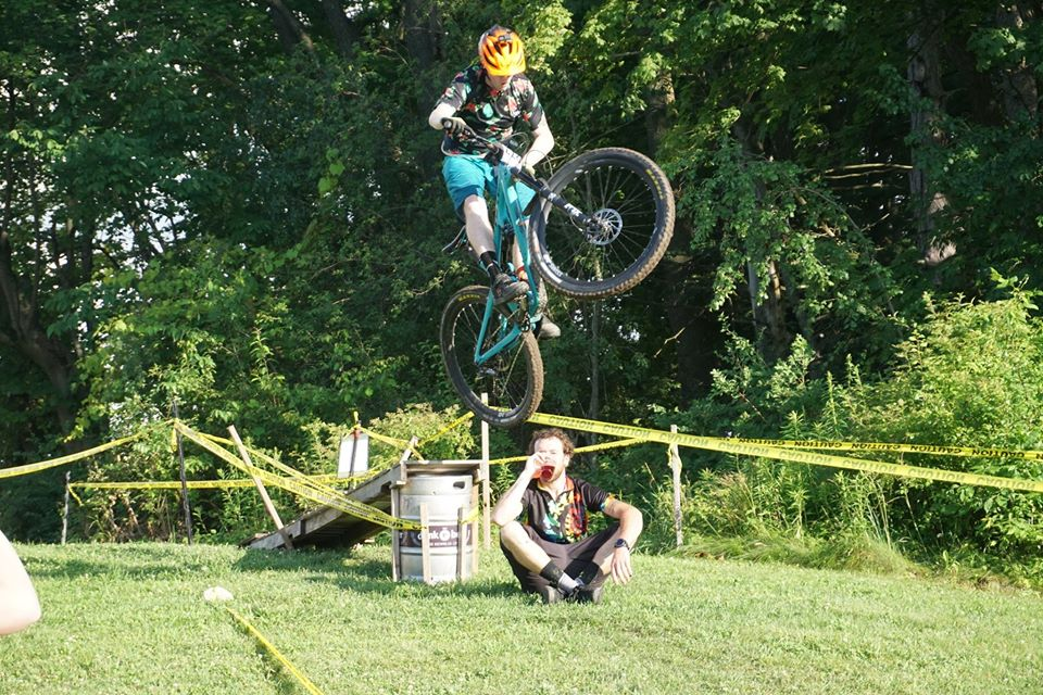 Mountain biker jumping off an obstacle.
