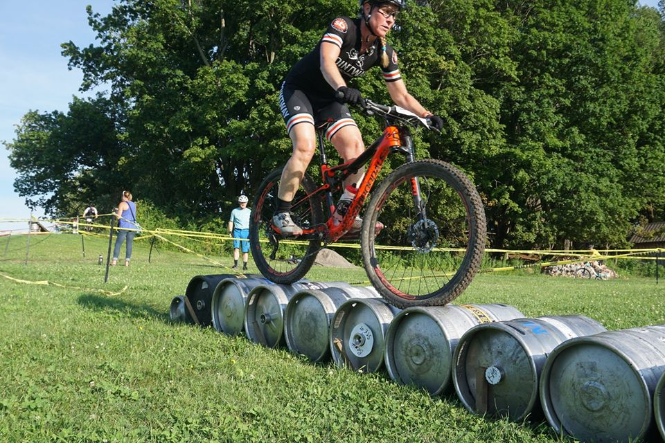 Mountain biker riding over an obstacle.