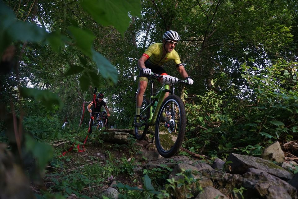 Mountain bikers riding through trails.