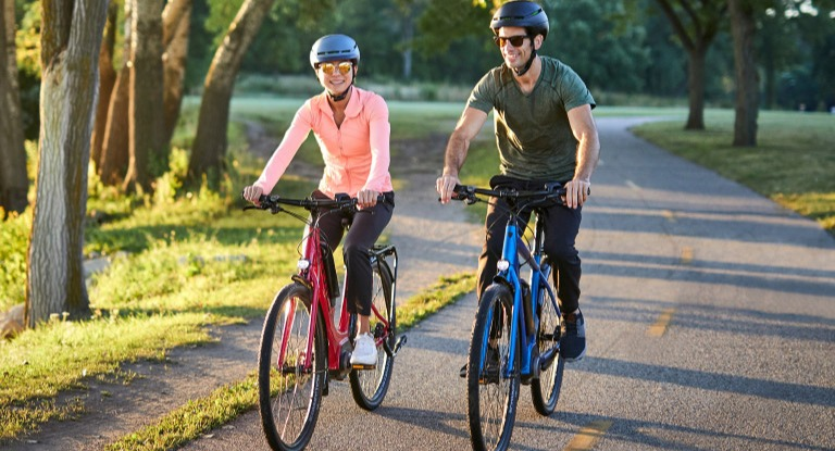 Couple riding electric bikes
