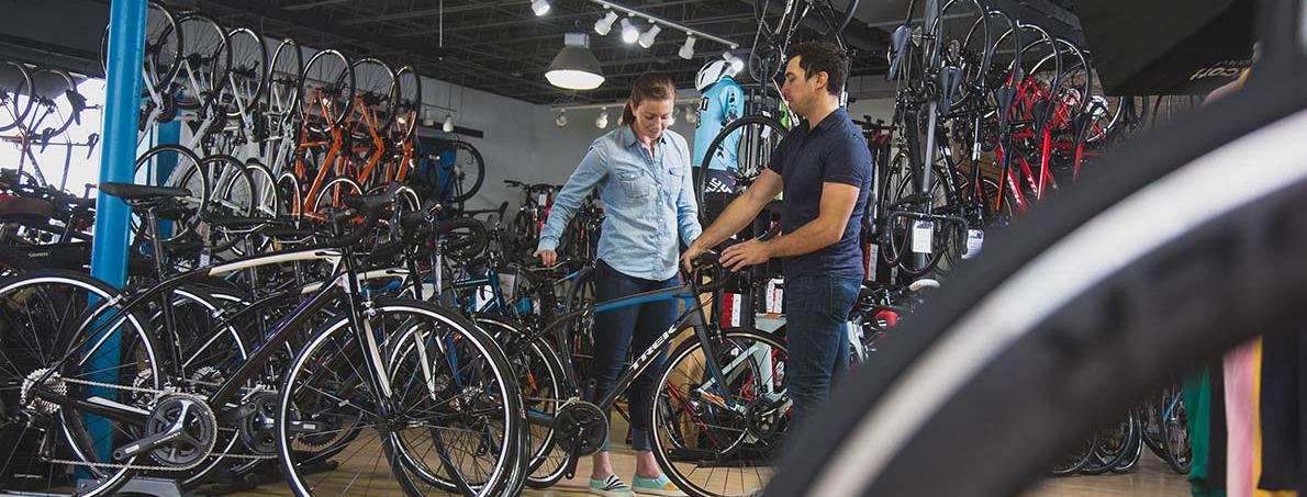 Employee showing a bike to a customer