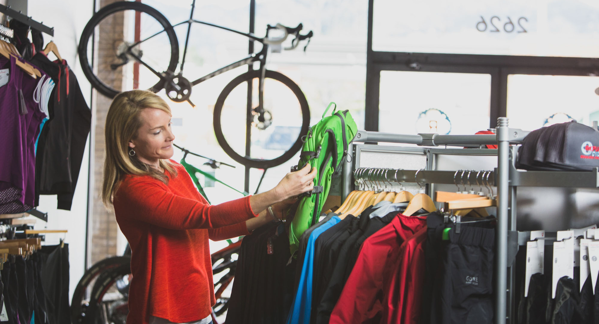 Woman looking at cycling jersey