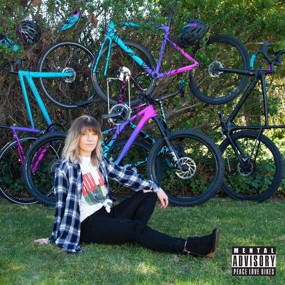 Woman posing in front of Specialized's MixTape Collection