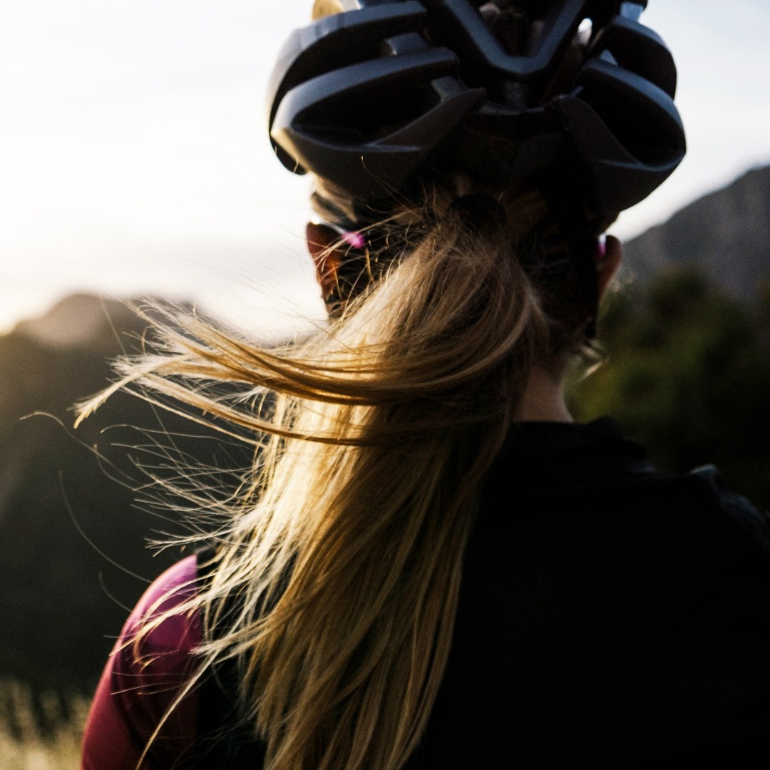 Woman with ponytail wearing a Bontrager helmet