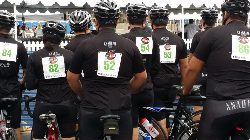 cyclists wearing race tags