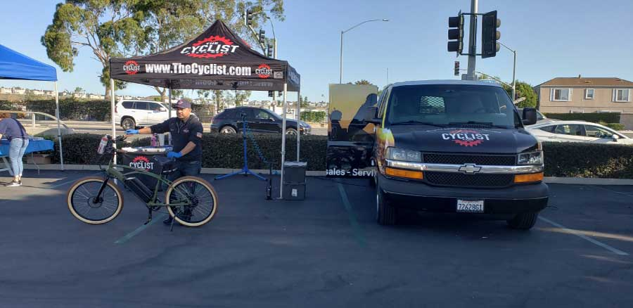 employee with electric cruiser bike