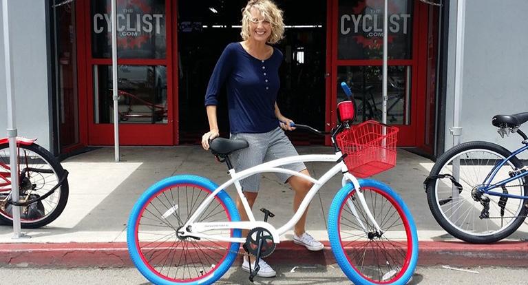 Happy Customer standing with her new bike