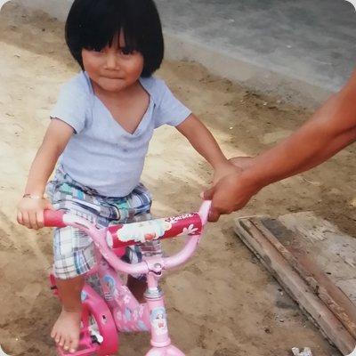 little girl on pink bike