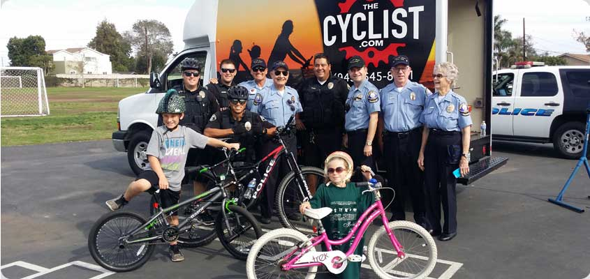 header image of police department with two young bike riders