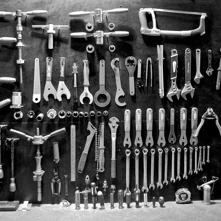 Photo of a bike mechanic's workbench stocked with tools